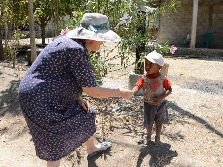 Di in Timor with kid